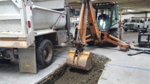 Excavator Digging Through Concrete